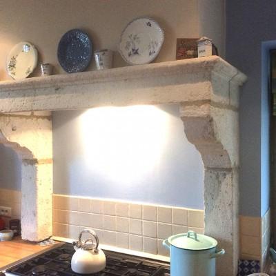 Kitchen stone fireplace